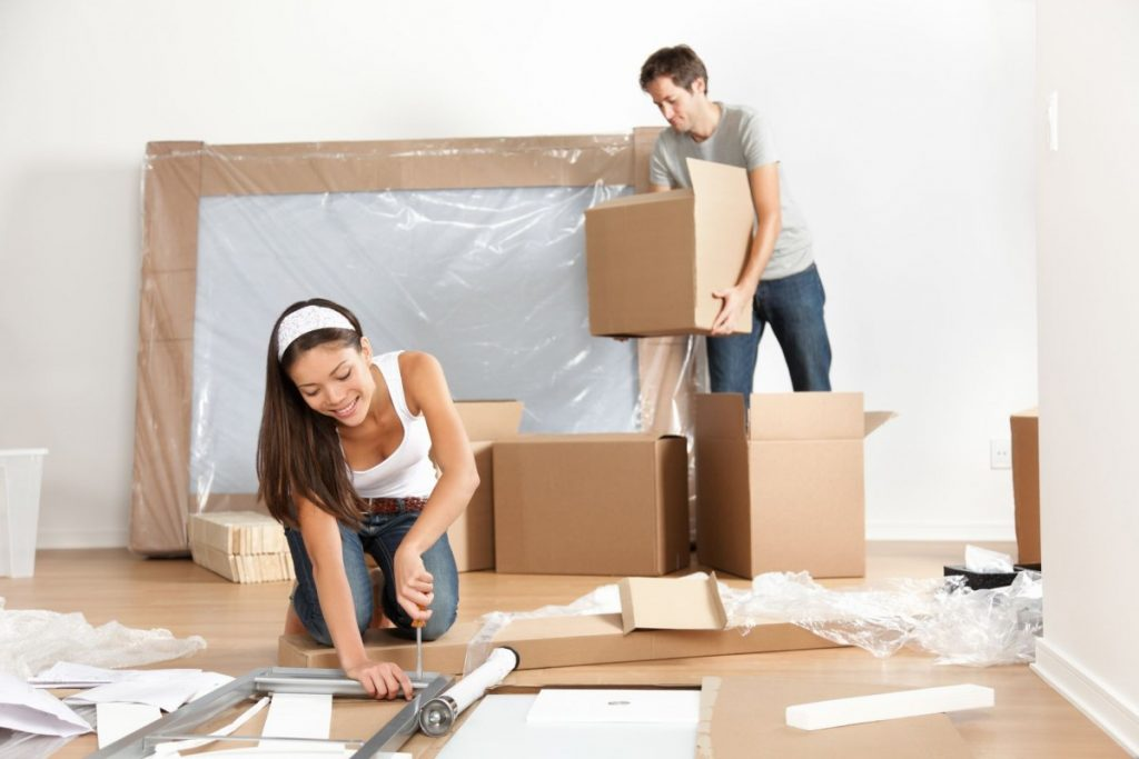 husband and wife using safe moving practices