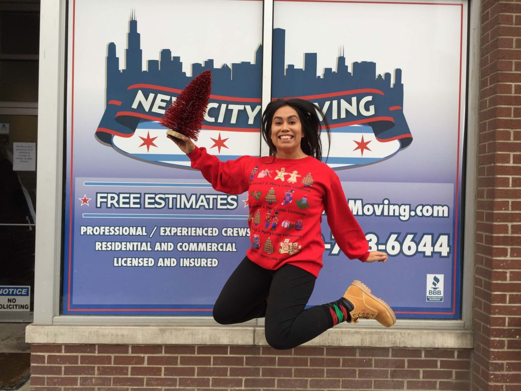 new city moving employee jumping in the air