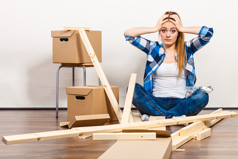 stressed customer trying to put furniture together